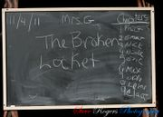 The _Cover to Cover_ blackboard, showing the book title and the chapter assignments.